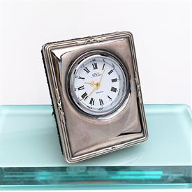 ",MINIATURE CLOCK WITH PICTURE FRAME STYLE BACK. 2.75"" TALL, 2.1"" WIDE"
