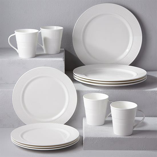 SEVEN DEGREES 12 PIECE SET. INCLUDES 4 DINNER PLATES, 4 ACCENT PLATES, & 4 MUGS. MSRP $332.00