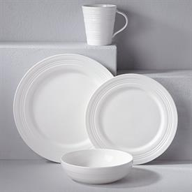 -FOUR DEGREES 4 PIECE PLACE SETTING. MSRP $108.00