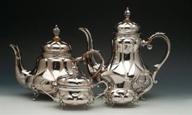 ",GERMAN 4 PIECE BEAUTIFUALLY STYLIZED STERLING HAND MADE TEA & COFFEE SERVICE WEIGHS 80.80 TROY OUNCES COFFEE POT 9.75"" TALL TEA POT 7.75"""