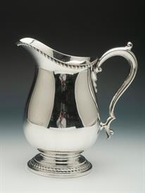 ",WALLACE STERLING SILVER WATER PITCHER CONTAINS 25.35 TROY OUNCES 4 PINT CAPACITY PITCHER 9.2"" TALL"