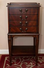 -Free Standing Southern Colonial Style Table Chest of Hardwood finished in dark cherry veneers. Made by Butler Specialty products since 1930
