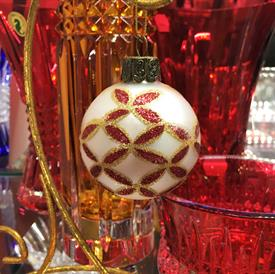 "LARGE IVORY & RED BLOWN GLASS ORNAMENT. 2.25"" WIDE"