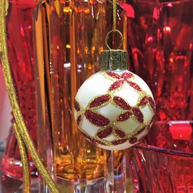 ",SMALL IVORY & RED BLOWN GLASS BALL ORNAMENT. 1.5"" WIDE"