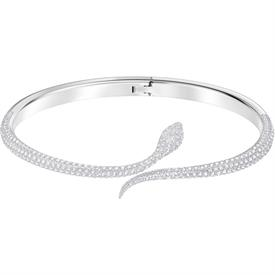 "-,5402542 LESLIE SNAKE BANGLE IN CLEAR & RHODIUM PLATE. 2"" WIDE, 1.65"" TALL (AT CENTER)"