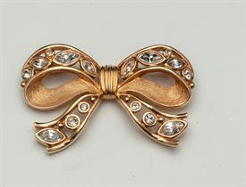 ",BOW BROOCH WITH CLEAR CRYSRALS. SWAN MARK ON BACK. 2.2"" LONG, 1.4"" TALL"