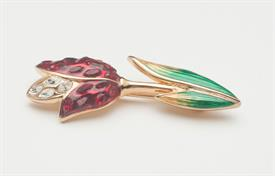 ",ULIP BROOCH IN GOLD WITH RED & CLEAR CRYSTALS & GREEN & GOLD ENAMEL. SIGNED ON BACK WITH SWAN. .75"" WIDE, 1.9"" TALL"