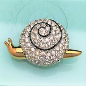 ",SNAIL BROOCH IN GOLD & SILVER WITH CLEAR CRYSTALS & BLACK ENAMEL. SIGNED ON BACK WITH SWAN. 1.5"" LONG, .9"" TALL"