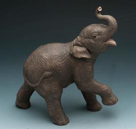 "ASIAN ELEPHANT FROM THE ENDANGERED ANIMAL SERIES 8""H X 6""W. COMES WITH ORIGINAL BOX NO COA"