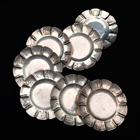 ,SET OF 7 SIGNED L. MACIEL STERLING MAYAN/AZTEC INSPIRED DISHES. HAND DECORATED. CA. 1940'S