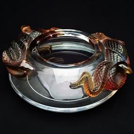",BAMAKO SEPERNT SNAKE VASE. DESIGNED BY MARIE-CLAUSE LALIQUE IN 1974. MINOR SCRATCHING FROM USE. 3"" TALL X 8.75"" DIAMETER"