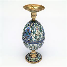 ",ENAMELED CUP EGG. 2.5"" EGG OPENS TO FORM 2 2 3/8"" CUPS. WHEN CUPS ARE STACKED THEY MEASURE 4.5"" TALL. SLIGHT ENAMEL DAMAGE."