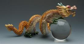 "_,308001C AMBER DRAGON HOLDING CRYSTAL BALL 11""IN LENGTH HAS AMBER AND GOLD CRYSTALS ALL OVER"