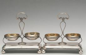 ",PAIR OF SALT CELLAR/SPICE RACKS 17.85 TROY OUNCES OF SILVER MADE IN FLORENCE, ITALY POSSIBLE IN THE 18TH CENTURY 5"" LONG BY 2.5"" WIDE 5.25"""