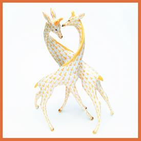 ",15283 GIRAFFE PAIR W/ BUTTERSCOTCH YELLOW FISHNET AND GOLD ACCENTS. 7.75""T X 6""W X 4""D"