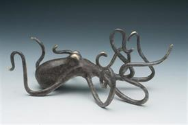 "_,80271 GRASPING OCTOPUS 8.5""IN LENGTH GREY WITH GOLD HIGHLIGHTS."