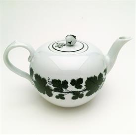 ",FULL GREEN VINE TEAPOT & LID. SMOOTH VARIATION. 4 CUP CAPACITY. 4.35 TALL, 8"" LONG, 5.2"" WIDE. SMALL CHIP ON LID"
