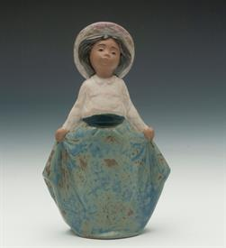 "'GIRL PICKING UP HER SKIRTS' #11041, GRES. 6.75"" TALL"