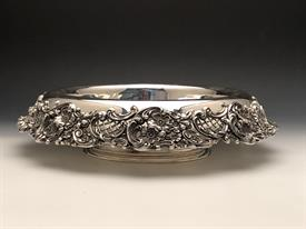 ",REDLICH & CO. NEW YORK,NY STERLING CENTERPIECE BOWL. 45.55 TROY OUNCES. 16"" DIAMETER BY 3.5"". FAIR CONDITION DENTS IN BOWL. CIRCA 1895-1946"