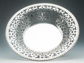 ",FRUIT BOWL WITH INTRICATE PIERCED DESIGN 21 OUNCES OF STERLING SILVER MADE BY HOWARD & COMPANY 10"" DIAMETER AND 2.5"" TALL"