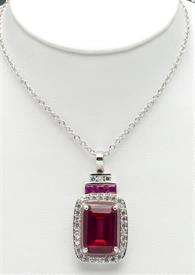 """-16""""RHODIUM PLATED PENDANT WITH RED STONE CENTER ENCIRCLED WITH CRYSTALS."""