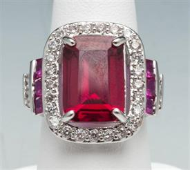 -SIZE 7 1/4 RUBY COLORED CRYSTAL RING WITH SILVER TONE METAL