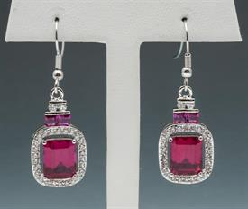 -Ruby colored and CZ drop earrings set in silver tone metal.