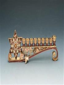 "-MENORAH 9""IN LENGTH 3"" TALL BROWNS AND BEIGE WITH YELLOW STONES."