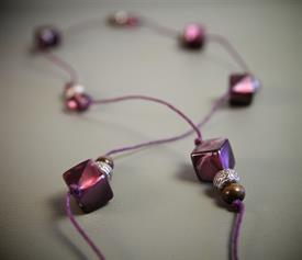 "-ESTHER NECKLACE. PURPLE GLASS, SILVER AND WOOD BEADING ON DYED PURPLE TWINE. 40"" LONG. SUPPORTS ""THE TABITHA PROJECT"""