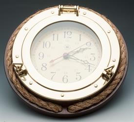 "-PORTHOLE CLOCK BRASS WITH ROPE ON SOLID WOOD.QUARTZ 13""DIAMETER."