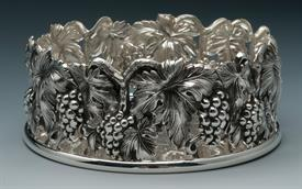 "-BOTTLE COASTER GRAPE CLUSTERS WITH LEAVES SILVER PLATED.5.25"" WIDE X 2"" DEEP."