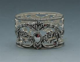 """_NAPKIN RING ORNATE SILVER PLATE 2""""WIDE OVAL."""
