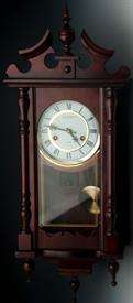 "_KASSEL 31 DAY WALL CLOCK. 32""T x 5.25""D x 12""W. 6.5"" CLOCK FACE. RETAIL VALUE $100"