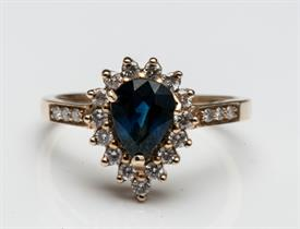 _14K YELLOW GOLD PEAR SHAPED SAPPHIRE WITH DIAMONDS. SIZE 7