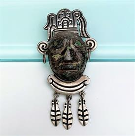 ",LARGE 1950'S CARVED STONE & STERLING AZTEC WARRIOR FACE BROOCH/PENDANT BY 'HCE'. EXCELLENT CONDITION. 3.5"" LONG, 1.75"" WIDE"