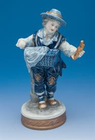 """GYPSY BOY WITH BASKET OF STATUES. VOLKSTEDT PORCELAIN, 1950'S-1960'S. WITH ORGINAL BOX 5.75"""" TALL"""