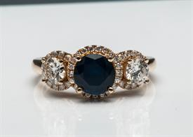 _14K YELLOW GOLD 1.75 CARAT SAPPHIRE RING WITH 1.07 CARATS OF DIAMONDS. SIZE 7