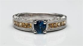 _14K WHITE GOLD RING WITH 1.23 CARATS OF BLUE AND YELLOW SAPPHIRES AND .40 CARATS OF DIAMONDS. SIZE 6.5