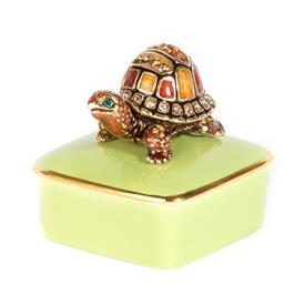 "-,CADEN TURTLE BOX. PORCELAIN BASE TOPPED WITH 14K GOLD FINISHED PEWTER, HAND ENAMELED & SET WITH SWAROVSKI CRYSTALS. 2"" TALL"