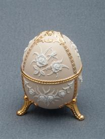 ,_CREAM ENAMEL EGG SHAPED MUSIC BOX. PLAYS PACHELBEL'S CANON