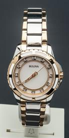 -WOMEN'S TWO TONE GOLD AND SILVER TONE DIAMOND WATCH CASE DIAMETER:32MM CASE THICKNESS:8MM WATER RESISTANCE:30M