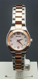 -WOMEN'S TWO TONE SILVER AND ROSE GOLD TONE WATCH