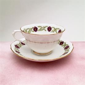 ,ART DECO ERA ROYAL ALBERT CROWN CHINA TEA CUP AND SAUCER. UNKNOWN PATTERN. HAND PAINTED, STYLIZED PURPLE FLOWERS. CA 1927-1935.