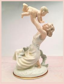 ",'MOTHER'S DARLING' LIMITED EDITION PORCELAIN SCULPTURE DESIGNED BY K. TUTTER CA 1940S. HAND PAINTED & INITIALED BY ARTIST. 11"" TALL."