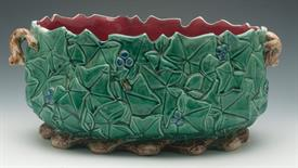 """,MAJOLICA JARDINIERE 13.25""""L X 9.25""""W X 7""""T THERE ARE A FEW CHIPS AROUND THE TOP OF THE PIECE"""