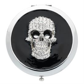 "-,SKULL COMPACT. STAINLESS STEEL MIRRORED COMPACT WITH CAST PEWTER, HAND SET CRYSTALS, & ENAMELING. 3"" WIDE, 1.5"" DEEP"