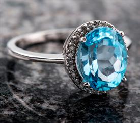 _WHITE GOLD 10K BLUE TOPAZ WITH .15 CARATS OF DIAMONDS ORIGINALLY $199