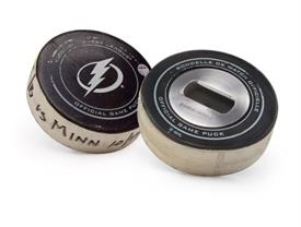 -,PUCK BOTTLE OPENER. GAME USED PUCK BY TAMPA BAY LIGHTNING.