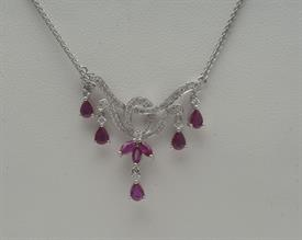 18K WHITE GOLD, 1.02 CARAT RUBY AND .41 CARAT DIAMOND NECKLACE 16 INCHES LONG 6 GRAMS GROSS WEIGHT
