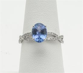 14K YELLOW GOLD, 14K WHITE GOLD, 1.5 CARAT TANZANITE AND .34 CARAT DIAMOND RING 3 GRAMS GROSS WEIGHT SIZE 7